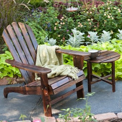 Coral Coast Torched Adirondack Chair Set with FREE Side Table - Inviting you to sit down, relax, and soak in the sunshine, the Coral Coast Torched Adirondack Chair Set with FREE Side Table is the perfect way to unwind with a friend. With wide arms and fan backs, these two chairs have all the features of traditional Adirondacks, plus an ergonomic design that follows the natural contours of your body to ensure you sit in comfort for hours on end. Constructed of Fir wood, the chairs are finished in fade-resistant two-tone torched brown. A matching round side table ins included so you'll always have the perfect place to set your drinks. These Adirondack chairs require some assembly and come with easy-to-follow, detailed instructions and all necessary hardware.About Asian FirAsian fir has characteristics very similar to Cedar. Well known for its combination of stability and light weight, it is commonly used in furniture, both here and abroad. While being naturally weather-resistant, it may be further stained or finished to endure and age gracefully for many years. If left unfinished, the wood will fade to a silver gray when used outdoors. Like Cedar, the grain is usually straight and displays prominent growth rings and knots.Wooden Outdoor Furniture Care and MaintenanceThe finish on wood outdoor furniture when exposed to an environment with substantial temperature changes (moisture, sun and salt air) can change over time. It is not uncommon and users should expect some swelling, discoloration or possible surface cracks due to the outside exposure and changes in the weather. These are considered natural occurrences of wood and should not be considered as a product defect. To prolong the life of your item you should consider placing under a covered area.About Coral CoastWhat if, when you closed your eyes, you pictured yourself in your own backyard? Coral Coast has a collection of easygoing, affordable outdoor furniture and accessories for your patio, pool, and backyard. Th