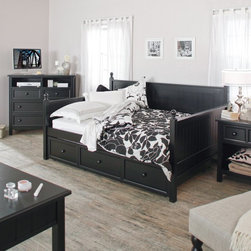 Fashion Bed Group - Casey Daybed - Black - Full - RN744 - Shop for Daybeds from Hayneedle.com! You'll have plenty of room to relax on the Casey Daybed - Black - Full - whether you share the bed or have it all to yourself. This modern full-size daybed makes a welcome centerpiece for your guest room but it can just as easily inspire mind-rejuvenating naps in your den or office. Subtle cottage-style elements enhance the simple design including rounded post finials and beadboard sides and back made of solid slats of wood. A rich durable finish covers the sturdy all-wood frame giving the daybed a stylish appearance to match its reliable construction. Classic black finish for a rich dramatic look. Available only at Hayneedle this exclusive full daybed comes with an optional twin-sized roll-out trundle drawer. Use it empty as a spacious storage drawer or put up to an 8-inch-thick mattress inside to accommodate your growing family or overnight guests. (Trundle does not pop up.) With or without the trundle your mattress will rest securely on the included wooden slat support system which is positioned 15 inches above the floor. Assembly required. Ships via common carrier. Completing the collection is a lineup of clean-lined coordinating pieces. Choose from the following optional bedroom furniture pieces: a desk a media chest a nightstand and a vanity. The desk has two drawers the media chest has four drawers and two shelves the nightstand has one drawer and the vanity has two drawers. All items are crafted from sturdy wood and finished in black. Dimensions: Daybed: 81.25L x 55W x 46H inches Side panel: 33H inches Finial ball: 3H inches Slat system: 15 inches above the floor Optional twin-size trundle: 76L x 40W x 13H inches Bedroom Furniture Dimensions: Desk: 49.5W x 23.75D x 29.75H inches Nightstand: 27.75W x 16.75D x 28.75H inches Media chest: 47.5W x 18.84D x 42.5H inches Vanity: 49.5W x 23.75D x 29.75H inches About Fashion Bed GroupFashion Bed Group is a Leggett and Platt Company known for its innovative fashion beds daybeds futons bunk beds bed frames and bedding support. Created in 1991 Fashion Bed Group is a large consolidation of three leading bed manufacturers. Its beds are manufactured of genuine brass plated brass cast zinc cast aluminum steel iron wood wicker and rattan. Fashion Bed Group's products are distributed throughout North America from warehouses located in Chicago Los Angeles Houston Toronto and Ennis Texas.