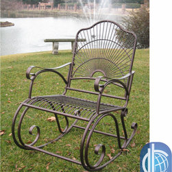 International Caravan - International Caravan Sun Ray Iron Rocker - Once you see this traditional iron rocker, you will want to spend every day sitting outside. The bold sun pattern on the back of the chair adds a decorative touch, and the hammered copper finish will mesh with any other outdoor furniture you have.