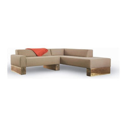 Beam Sectional Sofa by Shimna - This contemporary sectional sofa is perched atop oversized walnut beams that surprise us with their overscaled proportions.