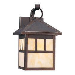 Seagull - Seagull Prairie Statement Outdoor Wall Mount Light Fixture in Antique Bronze - Shown in picture: 8508-71 Single-Light Prarie Outdoor Wall Lantern in Antique Bronze finish with Champagne�Glass