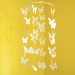 Butterfly Mobile Paper Mobile by Avis and Iris - Etsy has some great handmade options for mobiles, and I love the idea of having a flutter of butterflies hanging above a baby's crib.