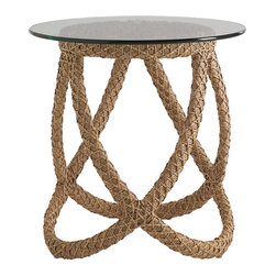 Frontgate - Aviano Outdoor End Table, Patio Furniture - Seagrass tone enhances the rope-like quality of the wicker base. Tempered glass top has a polished edge. High-density all-weather polyethylene wicker offers a high tensile strength, low maintenance and resistance to UV exposure, mildew, fading, staining, stretching and cracking. All-weather wicker is easy to clean with a mild solution of soap and water. Conjuring images of nautical ropes and windswept retreats, the Aviano Round Rope End Table features intersecting strips of all-weather wicker that create an elegant yet sculptural base. A simple circular glass top serves as a window for appreciating the hand-woven artistry and seagrass-hued texture of the wicker.  .  .  .  .