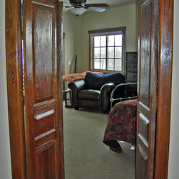 Reclaimed Hand Hewn Teak Doors and Frame From Central Java - An antique Javanese door, hand hewn from old growth teak, is installed in a contemporary house in Garden City, Idaho.  This door adds great character, interest and texture to this newly-built home.