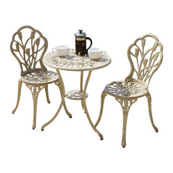 Great Deal Furniture - New England Cast Aluminum Bistro Set - Open a bistro for two on your balcony with the New England Cast Aluminum Bistro Set — chef not included! The refined floral design and rust-free material render the set pretty and practical. Insert an umbrella through the tabletop and make this seating area a focal point for all outdoor gatherings.