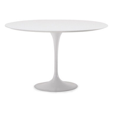 """Saarinen Dining Table - white laminate - hivemodern.com - Designed by Eero Saarinen in 1956, the classic tulip table was inspired by his disdain for """"the slum of legs"""" that were cluttering up U.S. homes."""