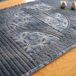 Table Runner - A quilted table runner made with quality fabrics from the Kasuri collection by Moda Fabrics. It has the feel of an antique piece and and is reminiscent of boro quilts. Fabrics are new, but made to look old.