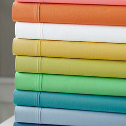 Fiesta Solid Percale Bedding - These colorful, lightweight cotton sheets got great reviews and are affordable. They're one of my favorites.
