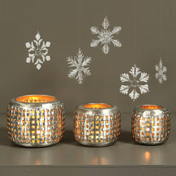 Lattice Tealight Holder - Alone or paired with  complimentary Lattice Metal Lantern, the lattice Tealight Holder is a shimmering and gorgeous way to softly illuminate a space. Place several on a mantel or cocktail table to enhance the mood at a small gathering of friends.  Small and simple but absolutely elegant, this tealight holder is a great way to update the look and feel of a space.