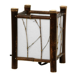 Oriental Furniture - Watashi Japanese Table Lamp - Dark - Compact Japanese table lamp in traditional shoji lantern style with a rustic flair. Hand crafted using lightweight but durable bamboo poles with a dark wood finish. Fiber-reinforced rice paper shade is embellished with natural thin twig embellishments and casts a warm, muted glow, while still providing a practical brighter light through the open top. Perfectly sized for extra lighting on a desk, end table, or paired on a bookshelf or mantel. Wired for standard American light bulbs and outlets.