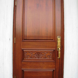 Single Mahogany Carved Entry Door - Single Mahogany wood carved entry door with 3 wooden panels with the middle panel being hand-carved finished in true mahogany stain color with antique brass Emtek standard door lock and hinges for a home in Bay Harbor.