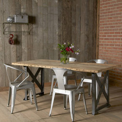 Salvaged Industrial Dining Table - Even formal dinners can have an element of rugged, rustic style at this tough and eco-friendly dining table. The Douglas fir boards in the tabletop are century-old salvaged barn wood, paired with distressed metal for a stellar industrial feel.
