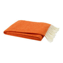 Soft Tangerine Throw - This Soft Tangerine Throw creates a sophisticated yet cozy look in any room. Made from a 50% cotton, 50% acrylic blend, the throw feels cashmere-soft and is versatile enough to drape over the sofa or bed's end. The throw's bold orange color throws the space a color splash yet remains completely classic and stylish. Italian-made, the accent piece can be used throughout the seasons, year round.