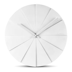 LEFF Amsterdam - LEFF Amsterdam Wall Clock Scope - This design shows a different perspective on time. Every angle will give a new experience. Erwin emphasized the inseparable elements time and light in the scope. Time is based on light and darkness and so is the shape of this clock. Twelve segments play with light and darkness as you pass.