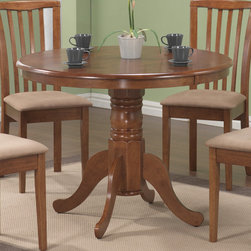 Coaster - Brannan Collection Dining Table in Oak - With relaxed elegance, this round pedestal table will make a charming addition to your breakfast nook or casual dining room. The delicate carved detail and generous curves of this single pedestal offer graceful designs. Arrange with matching upholstered side chair to add a touch of contemporary flair. Available in a warm maple finish.