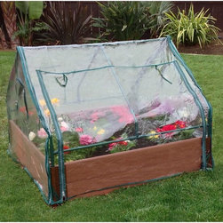 Frame It All - Frame It All One Inch Series Composite Raised Garden Bed Kit with Greenhouse - 4 - Shop for Greenhouses from Hayneedle.com! The Frame It All One Inch Series Composite Raised Garden Bed Kit with Greenhouse - 4ft. x 4ft. x 11in. provides a friendly environment for your favorite crops. This raised garden bed with greenhouse offers you an extended growing season and protection from unexpected weather events and pests. The greenhouse has zippered windows for easy access and control over humidity and temperature. The raised garden bed has a generous 11-inch bed size that almost any crop thrives in - even root vegetables. The composite material contains recycled plastic and sustainable hardwood fibers. Patented anchor joints work on hard surfaces like rooftops patios or decks as well as traditional landscapes. About ContechFounded in 1987 the Canadian Contech has grown steadily all-the-while developing a vision for eco-friendly and innovative products for the pet and garden industries. Through numerous mergers and acquisitions Contech has been able to further their vision of green pest control into new markets introducing non-toxic pest control to their repertoire of unique and effective products. Through their growth Contech has maintained an ideal of customer service with real-time customer service consultants all for the practice of thrilling their customers with better products that build a better world.