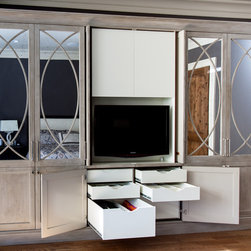 Giovanni Armoire - Collaborative deisng between Eidolon, Design Lines, LTD and client. His and Her sides accommodate all manner of clothing, accessories and shoes, as well as a flat screen TV on an articulating arm with all ventilation and wire routing in place before delivery.  Antique mirror glass on door exteriors have overlays created by an systematic templating process guaranteeing exact handmade duplication.  The far left and far right doors also have full length interior mirrors, adding weight requiring a 6 hinge sets on each door.