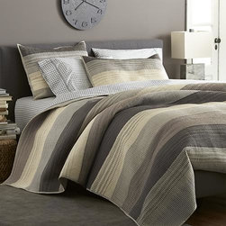Sedona Grey Full/Queen Quilt - Warm greys sweep in horizontal bands, accented with hand-guided embroidery. Polyester topside brings out the sheen, reversing to soft cotton. Linens have neat self-hemmed edges.