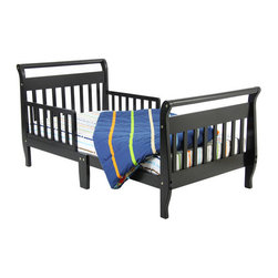 Dream On Me - Sleigh Toddler Bed - Looking for a transitional bed for your toddler? Look no further than the Sleigh Toddler Bed from Dream On Me! This solid wood bed features dual safety rails and a low height so that toddlers can easily climb in and out of bed and reinforced for stability with a center leg. An ideal choice for toddlers who have outgrown their cribs. Features: -Side safety rails on either side of the bed prevent toddlers from falling out. -Low height enables children to get in and out of bed easily. -Ideal for toddlers who have outgrown their cribs. -Easy assembly; all needed tools are included.
