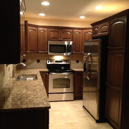 Very narrow kitchen - Bertch Marketplace Cabinetry, Alder Wood, Newman Arch Door Style, Mocha Stain