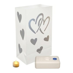 """Lumabase Battery Operated Hearts Luminaria Kit - Set of 12 - Illuminate your home with the love and glow of the Lumabase Battery Operated Hearts Luminaria Kit - Set of 12. Complete kit includes: 12 weather-resistant plastic bags 12 battery operated tea light candles (batteries included) 12 LumaBases (reusable flame-resistant plastic water weighted candleholder that anchors the luminaria). About JH SpecialtiesFounded in 1989 JH Specialties originated when the company's entrepreneurs sought to redesign a bulky and messy celebration staple. Today JH Specialties offers unique decorative Luminarias and accessories for special and seasonal occasions to event planners neighborhoods fundraising organizations and retail stores. Since special occasions shouldn't be hard to plan JH Specialties offer top-of-the-line products for unique events at a competitive price and a great value. The title of """"""""Leader in Luminarias"""""""" comes from their commitment to quality and customer service."""