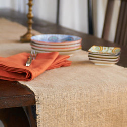 Origin Crafts - Burlap natural table runner - Burlap Natural Table Runner The Burlap tablecloth?s simplicity and utility make it a year round favorite. Its natural, jute fibers can be left unadorned for an understated glamour or dressed up with colorful accessories, such as our Kantha placemats or patterned napkins. A Caravan exclusive. Biodegradable and eco-friendly: made of 100% authentic jute fibers. Dry clean only. Dimensions (in):Available in two sizes: 16x72 inches and 16x90 inches By Couleur Nature - Couleur Nature is a wholesaler of fine, French-inspired Indian woodblock-printed and vintage linens. Couleur Nature?s linens and home accessories are versatile and can be used for formal or casual table settings year-round, as well as the every day. Their distinct but wide appeal makes them ideal for almost any occasion, decor or personal style. Usually ships in three business days. Our linens are handmade: slight variations are natural and make each piece unique.