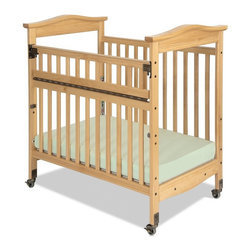 Foundations - Foundations Biltmore SafeReach Clearview Compact Crib - Natural Multicolor - 184 - Shop for Cribs from Hayneedle.com! The Foundations Biltmore SafeReach Clearview Compact Crib - Natural is beautiful style combined with the ultimate in safety and function. When you want to make a statement in style and quality turn to the Biltmore crib. Headboards feature arched crown molding while beading details the perimeter of the crib to make this crib the most luxurious crib available today in a compact size. Color coordinated finishes are matched with hardware and casters for added beauty. High-quality construction includes mortise and tenon joinery and high strength fasteners for superior durability. Solid steel SafeSupport crib frame has a lifetime warranty. Fixed-side crib features a lower profile providing easier accessibility to infant while reducing back strain for caregiver. The SafeReach infant access system provides a safe alternative to infant access. This revolutionary new system enables caregivers to lower the side rail to access infant while minimizing the risk of back strain. Innovative hinging and latching system eliminates all pinch point hazards to infant. Smooth plastic teething rails protect child and crib while making it easy to sanitize. Crib has full 5 year warranty with lifetime warranty on frame casters and hardware. Includes Professional Series 3-inch ultra-durable antimicrobial mattress and includes 2-inch non-marking ultra-quiet casters (2 locking). Adjustable 2 position mattress board. Crib features Clearview end panels which allow for easy viewing of infant. Dimensions: 40.4L x 27.65W x 41.15H inches. About FoundationsFoundations is a brand focused on the absolute safety and well being of all children and their products show it. Though used throughout the world by commercial customers Foundations products extend to use in the home as well.