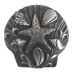 "Notting Hill - Notting Hill Seaside Collage Knob - Antique Pewter - Notting Hill Decorative Hardware creates distinctive, high-end decorative cabinet hardware. Our cabinet knobs and handles are hand-cast of solid fine pewter and bronze with a variety of finishes. Notting Hill's decorative kitchen hardware features classic designs with exceptional detail and craftsmanship. Our collections offer decorative knobs, pulls, bin pulls, hinge plates, cabinet backplates, and appliance pulls. Dimensions: 1-5/16"" diameter"
