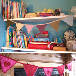 Crocheted Bunting in Custom Colors - Add whimsy and happiness to your boy or girl's room with a crocheted bunting. This banner, made of Courtelle yarn, is hand-crocheted in England. This simple addition to a space says that everyday can be a celebration.