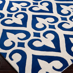 Zuna Rug - Cobalt - Hand-tufted in New Zealand wool, the dimensional fields of pure white and soft, cozy ocean blue in the Zuna Cobalt Rug suggest the crisp definitions and low-key, nostalgic charm of formal gardens and antique porcelain ware.  The pattern of heart and fleur-de-lis motifs comes together into a curvaceous lattice that alludes to the past but adopts a current pattern.