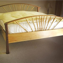 Sunrise Bed - This simple yet elegant design resembles the rays of the sun and will light up any bedroom with its beauty. It is built to fit a California King mattress and is made of Cherry and Wormy Maple. Pegged-through tenons accent both head and footboards.