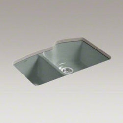 """Kohler - Wheatland Five Hole Offset Undercounter Double Kitchen Sink - The Wheatland offset double basin sink offers a clean, versatile design to compliment any dcor. The elegant, rhythmic composition of arcs creates a distinctive look, while providing enough basin space to hold a large pan lying flat, and it leaves space for faucet holes to be centered over the divider with an accessory hole to the side. The sink features a slightly lowered divider (1"""" below the sink rim), which minimizes splashing and water runoff onto the countertop. The shape and depth of the basins are large enough to accommodate larger kitchenware such as pots and pans. The rear placement of the drain provides maximized sink work surface, as well as ample storage space inside the kitchen sink cabinet. Features: -33"""" L x 22"""" W. -Basin depth 9"""". -Undercounter installation. -Offset basin. -Five-hole faucet drilling. -Kohler cast iron material. -Scratch resistant, stain resistant. -Guaranteed not to chip, crack or burn. -Environmentally friendly - 93"""" recycled and reclaimed material. -Nothing is easier to clean** - features a smooth, non-porous enamel surface. -Kohler cast iron sinks installed in north america carry a lifetime limited warranty for as long as the original consumer purchaser owns his or her home. -**In tests, no other surface was shown to be better at resisting food based stains than kohler cast iron. -Overall dimensions: 9.625"""" H x 33"""" W x 22"""" D."""