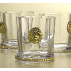 Set of Two Old Fashioned Glasses with 22K Gold Lion Heads - These bar glasses make such a statement. We would fill them with a signature cocktail. Mocha nog punch, anyone?