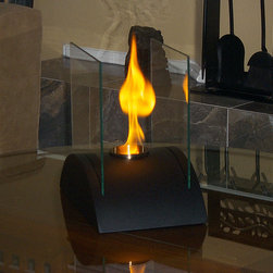 Estro Tabletop Bio Ethanol Fireplace by Nu-Flame - Estro, with its sleek, curved base, is ideal for creating emotional decor. Providing a 360 degree view of the dancing flame, Estro provides comforting warmth in a small space or patio. This fireplace offers an eco-friendly flame that is odorless. Bio Ethanol, an alternative fuel source produced from plants, only emits water vapor and carbon dioxide into the air. Although ethanol fireplaces aren't intended for use as a primary heat source, the Estro model produces some heat that will change the ambient temperature in a small space. For aesthetic appeal and safety, this fireplace includes two panes of tempered glass, positioned on the long ends, that frame the flame and provide the unobstructed view. Appropriate for any living space, inside or out, Estro's base is offered in a black powder-coated steel.