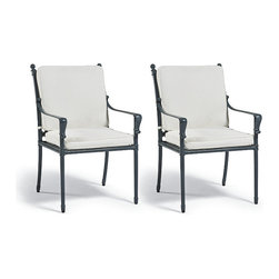 Frontgate - Campaign Set of Two Dining Outdoor Arm Chairs with Cushions, Patio Furniture - Solid cast aluminum frame and ornamentation. Hand-applied verde patina finish comes with a three-year warranty. Generously proportioned seating. Arrives with plush, all-weather back and seat cushions. Cushions are constructed of a high-resiliency foam core with soft polyester wrap. Our Campaign Dining Arm Chair beautifully showcases cast-iron ornamentation and campaign styling in durable, solid cast aluminum. Perfectly pitched for comfort at the table, the chair's strong profile is tempered with classic fleur-de-lis and rosette decoration. The look is enhanced by our proprietary, 3-step finish, which has the desirable patina of iron that's been aged for 30 years. Part of the Campaign Collection.  .  .  .  .  . Finished with 100% solution dyed Sunbrella fabric covers that resist mold, mildew and fading . Imported.