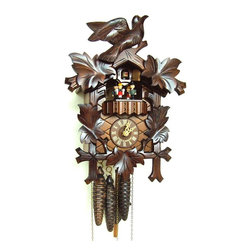 Schneider Cuckoo Clocks - 1-Day Carved Style Black Forest House Cuckoo Clock - 1-day rack strike movement. Wooden cuckoo, dial with roman numerals and hands. Shut-off lever on left side of case silences strike, call and music. Wooden cuckoo calls and strikes every half and full hour. Hand crafted and painted red dancing figurines. Made from wood. Antique finish. Made in Germany. 9.1 in. W x 6.3 in. D x 13 in. H (5.7 lbs.). Care Instructions