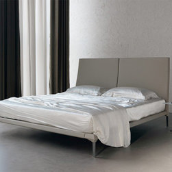 Cattelan Italia - Cattelan Italia | Maverick Bed - Made in Italy by Cattelan Italia. A refreshing take on Italian workmanship and design, the Maverick Bed radiates a carefree charm owing to its stylishly svelte physique. Don't be decieved by the weightless appearance of this masterpiece, made of solid steel, this modern bed is made to last. Bringing a luxurious look to the piece is the soft leather encasing the whole frame. And while the steel feet add to the chic factor, its elevates the bed at a high enough level so that the bottom space can be used for storage. Size and leather options offered. Mattress not included.
