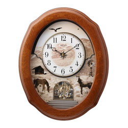 "Rhythm Clocks - 20"" x 16"" American Prairie Musical Clock - The American Prairie is a country style crowd pleaser. It is encased in a beautiful dark oak frame. Each hour the face splits in two and revolves around as one of 18 beautiful melodies play. The melodies include 6 Americana, 6 Hymns, or 6 Christmas melodies. It is also accented with a rotating crystal pendulum. Quartz clock is battery operated."