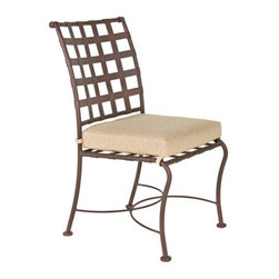 O.W. Lee Classico Wrought Iron Dining Side Chair - With its beautiful, classic design and superior craftsmanship, the O.W. Lee Classico Dining Side Chair is a gorgeous addition to your patio. Made from handcrafted wrought iron with rich, Old World craftsmanship, this chair brings comfort, style, and tranquility to your outdoor area. Perfect for your patio dining table, this dining chair allows you and your guests to sit in comfort while enjoying a good meal. The Sunbrella cushion, available in your choice of color, is resistant to stain, mildew, water, and fading and is easy to keep clean with mild soap and water. You can also use the Classico Dining Side Chair as a stand-alone piece scattered around your patio or deck for extra seating. Your friends will love coming over to your home to enjoy the summer air, a good drink, and great conversation.Please note: This piece will be delivered with White Glove service which includes location placement. Unpacking and assembling the item will be left to the customer. Due to the custom-made nature of this item, orders usually ship within approximately 5 weeks. Because each item is assembled just for you, orders cannot be cancelled. A 50% restocking fee will apply for returns.This item is custom-made to order, which means production begins immediately upon receipt of each order. Because of this, cancellations must be made via telephone to 1-800-351-5699 within 24 hours of order placement. Emails are currently not acceptable forms of cancellation. Thank you in advance for your consideration in this matter.Materials and construction:Only the highest quality materials are used in the production of O.W. Lee Company's furniture. Carbon steel, galvanized steel, and 6061 alloy aluminum is meticulously chosen for superior strength as well as rust and corrosion resistance. All materials are individually measured and precision cut to ensure a smooth, and accurate fit. Steel and aluminum pieces are bent into perfect shapes, then hand-forged with a hammer and anvil, a process unchanged since blacksmiths in the middle ages.For the optimum strength of each piece, a full-circumference weld is applied wherever metal components intersect. This type of weld works to eliminate the possibility of moisture making its way into tube interiors or in a crevasse. The full-circumference weld guards against rust and corrosion. Finally, all welds are ground and sanded to create a seamless transition from one component to another.Each frame is blasted with tiny steel particles to remove dirt and oil from the manufacturing process, which is then followed by a 5-step wash and chemical treatment, resulting in the best possible surface for the final finish. A hand-applied zinc-rich epoxy primer is used to create a protective undercoat against oxidation. This prohibits rust from spreading and helps protect the final finish. Finally, a durable polyurethane top coating is hand-applied, and oven-cured to ensure a long lasting finish.About SunbrellaSunbrella has been the leader in performance fabrics for over 45 years. Impeccable quality, sophisticated styling and best-in-class warranties prove the new generation of Sunbrella offers more possibilities than ever. Sunbrella fabrics are breathable and water-repellant. If kept dry, they will not support the growth of mildew as natural fibers will. Beautiful and durable, Sunbrella is a name you can trust in your outdoor furniture.About O.W. Lee CompanyAn American family tradition, O.W. Lee Company has been dedicated to the design and production of fine, handcrafted casual furniture for over 60 years. From their manufacturing facility in Ontario, California, the O.W. Lee artisans combine centuries-old techniques with state-of-the-art equipment to produce beautiful casual furniture. What started in 1947 as a wrought-iron gate manufacturer for the luxurious estates of Southern California has evolved, three generations later, into a well-known and reputable manufacturer in the ever-growing casual furniture industry.