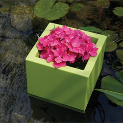 Cubotti Outdoor Planters by Serralunga - Cubotti Outdoor Planters by Serralunga. Furnishing accessory for contemporary settings. Cubic pot, basic shape with micro- dotted surface, suitable for decorating modern and refined locations. This pot is lifted slightly from the ground and can be used for direct potting (as a cachepot) or for hydroponics. Available also a size with a slender shape. Cubotti Outdoor Planters by Serralunga are designed by Nat Wave.