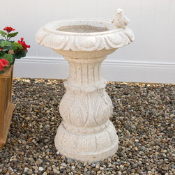 Beige Granite Pedestal Birdbath with Bird Accent - Give your garden birds an inviting place to bathe with this natural, hand-carved Beige granite birdbath. It features a carved, decorative bird along the rim for a charming accent.