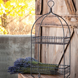 """2 Tier Bakery Basket - Lovely muted gray wire flips and swirls and arches around two generous lipped shelves to a finger ring handle. We call it a bakery basket but it would also answer to """"vegetable basket"""" or """"fruit basket"""" or """"place to hold soaps, washcloths and stuff"""" basket."""