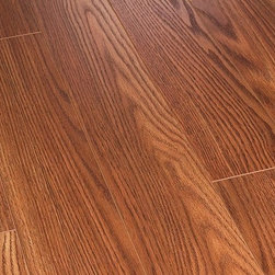 Toklo - Toklo Laminate - 12mm US Collection - [14.0 sq ft/box] - Colonial Harvest Oak -    The Toklo 12mm US collection is a first-quality, high-end, AC3 Rated, CARB-ATCM - Phase 1 compliant, HDF core flooring.     The drop lock locking system allows for ease of installation without using glue and can be installed above or below ground. This laminate flooring is suitable for residential and light commercial applications and comes with a 30 year residential warranty (5 year commercial warranty).     Surface Type:    Handscraped Finish: Greybeard Oak  Smooth Finish: Montreal Hickory and Centennial Maple  Wood Grain Finish: Brandywine Oak and Colonial Harvest Oak