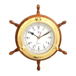 Bey-Berk International 13.5 in. Brass/Oak Ships Wheel, Clock - Tarnish Proof - Your deckhands will envy your Bey-Berk International 13.5 in. Brass/Oak Ships Wheel, Clock T.P.. Elegant on a home or office wall, or below deck on your water vessel, this metal and wood clock is easy to read. This well-crafted timepiece has an analog quartz-movement, plus a solid brass, tarnish-proof bezel and oak frame. About Bey-Berk InternationalThis quality item is created by Bey-Berk. For more than 20 years, Bey-Berk International has crafted and hand-selected unique gifts and accessories from around the world to meet the demands of discerning customers. With its line of elegant and distinctive products, Bey-Berk has established itself as a leader in luxury accessories.