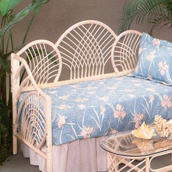 Yesteryear Wicker - Pan Pacific Daybed - YY056 - Shop for Daybeds from Hayneedle.com! The Pan Pacific Daybed features a unique open weave of thick wicker to bring refreshing airiness to any setting. Tightly woven wicker along the frame creates striking contrast when set against the lazily swirled design of the back and armrests. This daybed boasts hand-crafted quality so you can enjoy its beauty for years to come. Use this daybed to complete a guest room or sunroom and enjoy its breezy presence. Available in a brown or whitewash finish. This product arrives in two packages with simple assembly: Sides attach to the back with minimal effort. A trundle is an extra mattress frame stored beneath a daybed which slides out to provide additional sleeping space when needed. The optional trundle includes a metal pop-up-style trundle. They can be left in the lowered position or elevated in the pop-up position to align with the primary daybed mattress. The pop-up feature allows the daybed to transform from a twin-size daybed into a king-size bed. Creating a king-size bed out of a daybed and a pop-up trundle is easy and with the Create-A-King mattress connector it will be so comfortable you'll never know it comprises two twin mattresses. The Create-A-King mattress connector is available for purchase in the shopping cart.