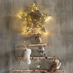 Grandin Road - Wicker Battery Operated Star - Lighted, three-dimensional star made from rattan. Features a sturdy, integrated hanging loop. Crafted from open-weave natural rattan with a rich brown finish. Requires three AA batteries (not included). Arrives ready to hang. Display our organically inspired, Wicker Battery-operated Star year round, indoors or out. Especially striking poised as a designer topper for your Christmas tree, cordless operation means you can bring an enlightened touch to just about anywhere. Think bookcases, a mantel, over a bar, or outdoors hanging from eaves or a tree. Pre-lit with 20 warm white LED's.  .  .  .  .  .