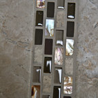 Stone & Glass  & Shell Mosaic Tile - 3/8 x 3/4 inch tile pieces are randomly blended and mesh-mounted in a brick pattern on approx. square foot sheets. Each color is a mix of shiny and matte glass, actual stone and mother of pearl pieces. As well as being used as field tile, the sheets can be cut and combined with other field tile to create cost effective feature strips and decorative inserts.