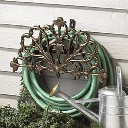 Ballard Designs - St. Marcel Hose Holder - Cast aluminum construction. Powder coated to resist rust. Lacy, foliate motif. Holds up to 100' feet of hose. This decorative Hose Holder keeps your hose near the spigot and easy to reach. Holds up to 100' of standard size garden hose. Crafted of cast aluminum with lacy foliate decoration and powder coated to resist rust and weather. Made in the USA. Simple assembly.Hose Holder features:. . . .