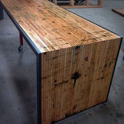 Butcher block countertops - This top, made out of reclaimed boxcar flooring, feature a drop down leg and is wrapped in steel. We chose to leave lots of character and markings in it to show off its past, all digs and markings in the wood have been sealed and are smooth to the touch.