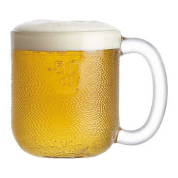 Iittala Krouvi 20 oz. Beer Mug - The comeback of a Scandinavian quaffing classic. Iittala's textured Finnish pub mug designed by Oiva Toikka in 1973 features a friendly broad shape, smooth polished rim and embossed measurements. Freezer-safe for the frostiest brew.